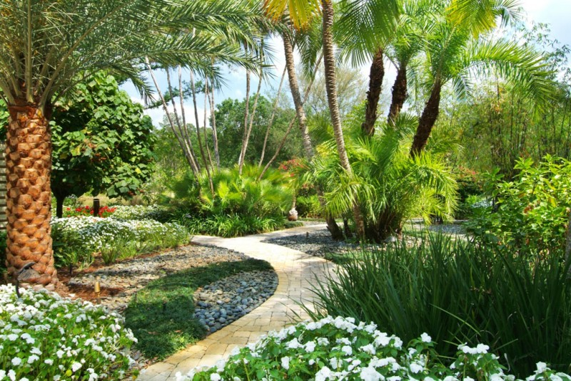 lush tropical gardens with walkway