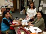 Volunteers planning for a special Hanafuda Hawai'i event! Photographed by Joseph Kamiya.