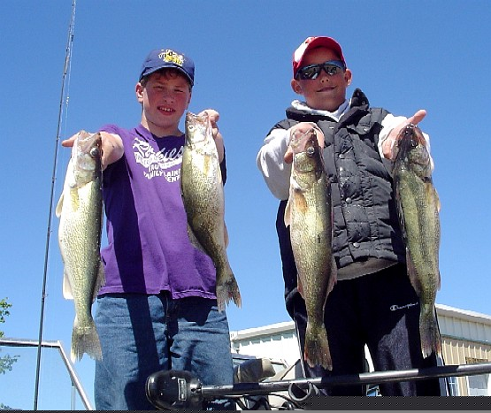 Mike and Max showing off their two biggest walleye of the day