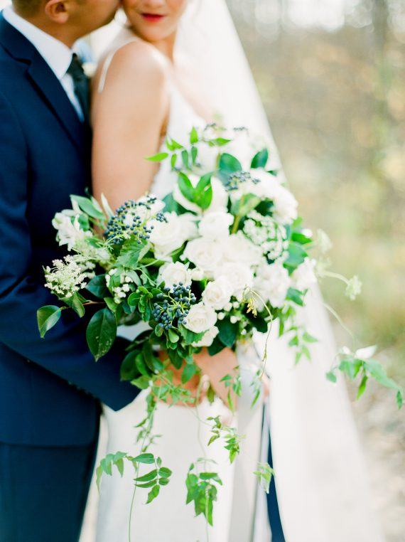 White and blue bouquet by Oak & Lily Flowers Photo by Brittany Mahood br-wedding338