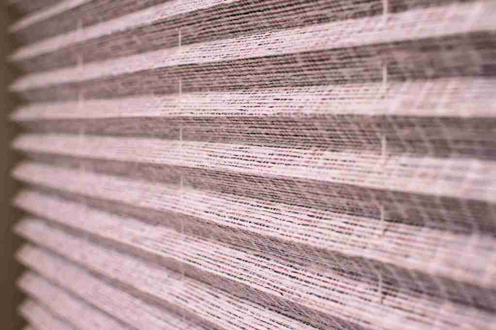 close up pink pleated blinds