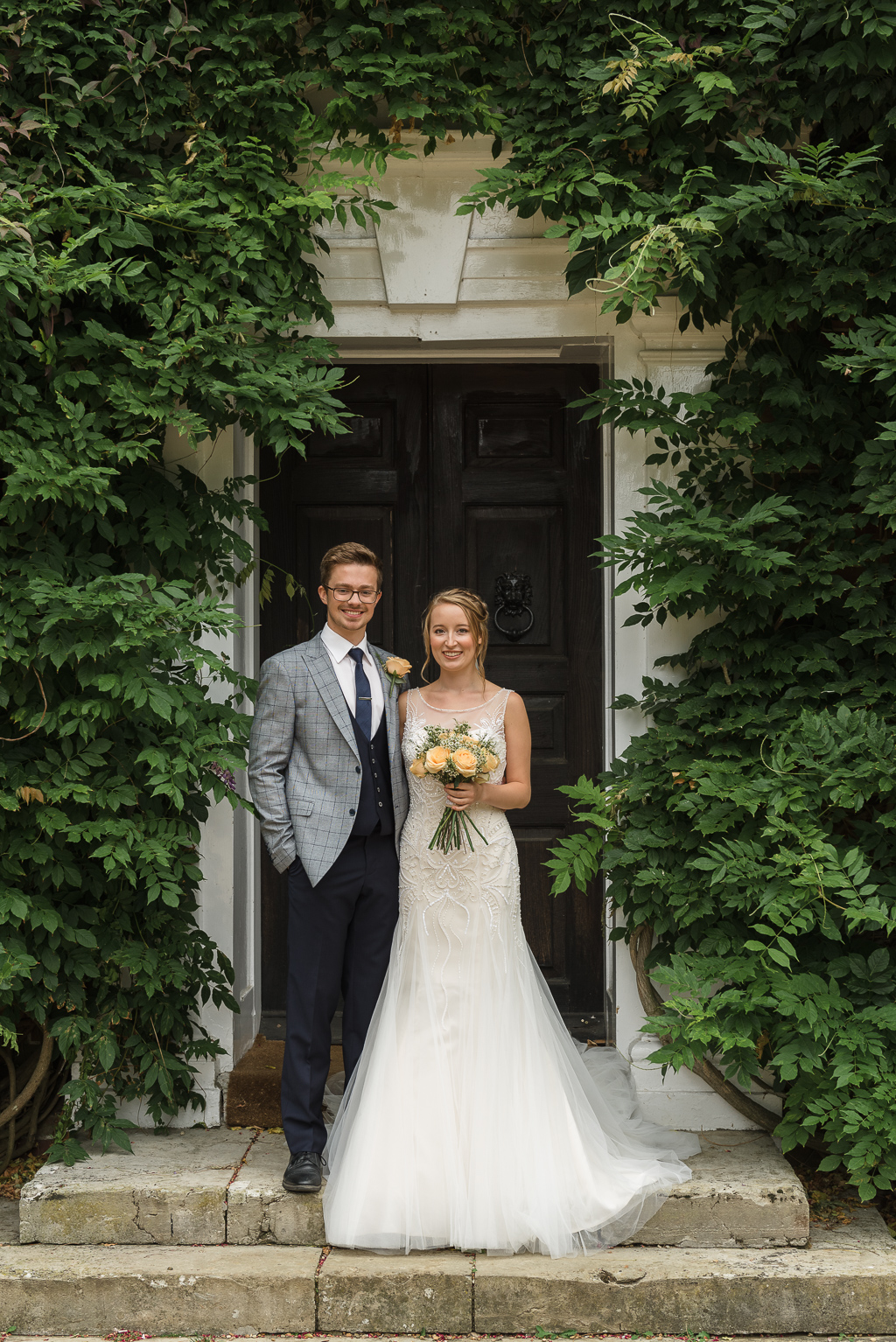 Bride and Groom posing outside Sprivers Mansion Elopement Photo Shoot | Kent Wedding Photographer | Oakhouse Photography