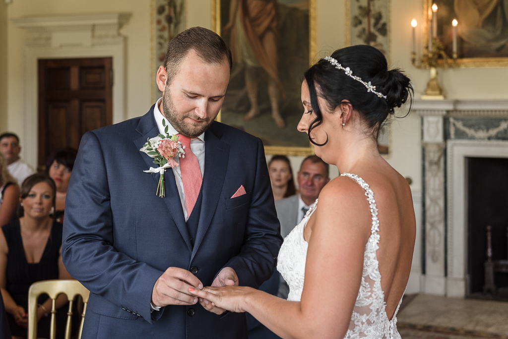 Bride and groom exchanging rings at Danson House Bexley wedding | Oakhouse Photography