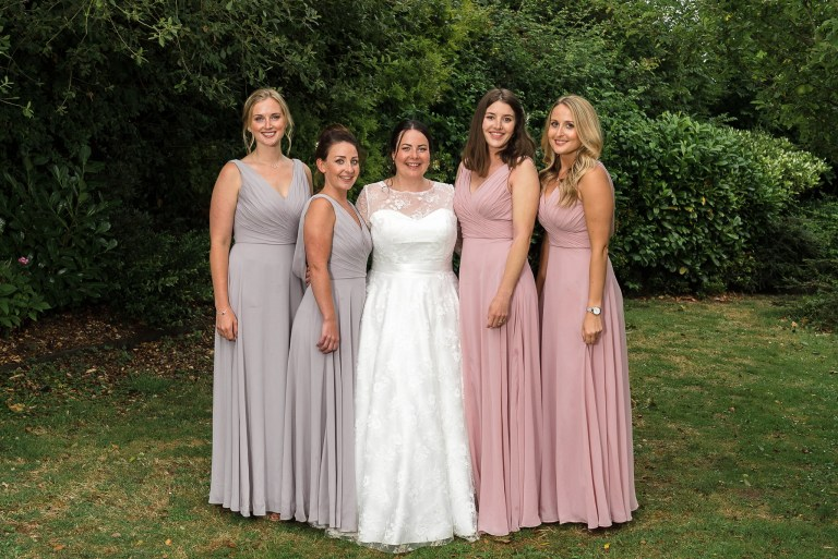 Bride and bridesmaids group photograph at Swallows Oast wedding venue, Ticehurst, East Sussex | Oakhouse Photography