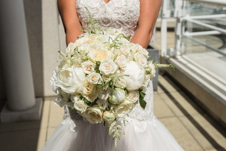 Bride holding wedding flower bouquet at the Chelsea Harbour Hotel, Chelsea, London