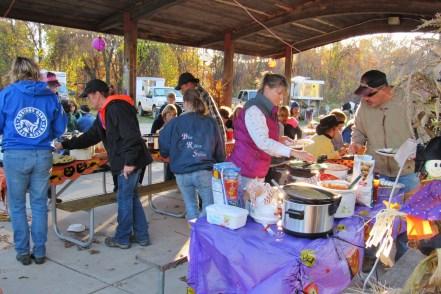 Campers enjoy a potluck dinner.