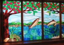 Cyclists paused to explore the stained glass of the Paint Creek Cider Mill.