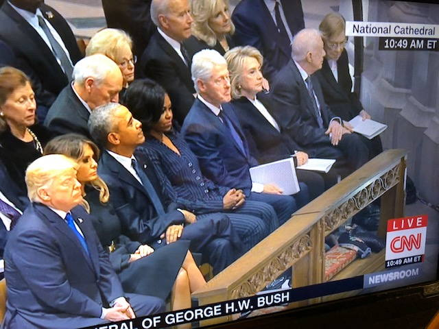 Donald Trump Goes To Sit With Obamas And Clintons Awkwardly At George HW Bush Funeral