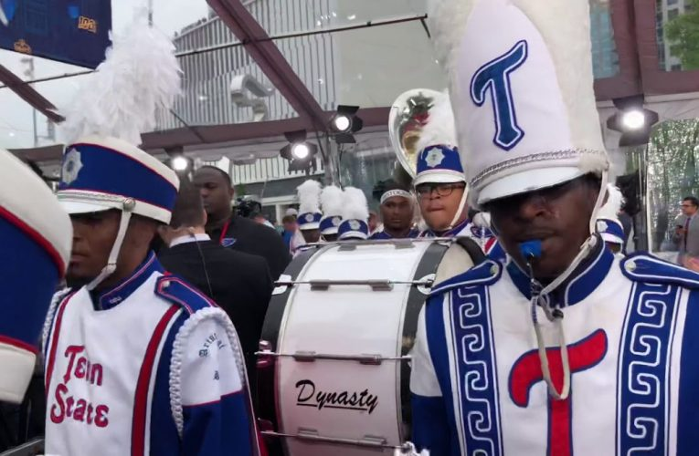 High-Fiving Tennessee State Marching Band At 2019 NFL Draft Red Carpet