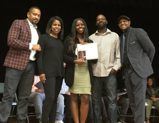 Tim White (L) and Roland Broach (R) presenting a scholarship to Oakland Tech senior, Suniya Barnes and her family last spring.
