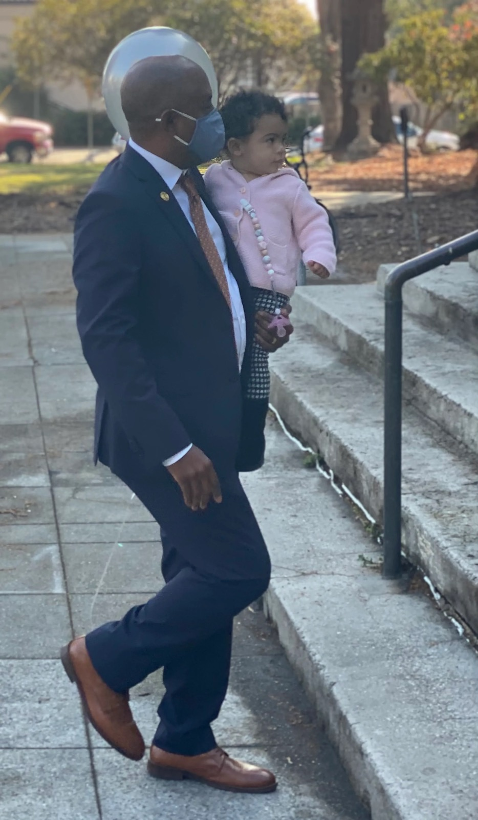 Ben Bartlett carries his Daughter to swearing in ceremony.