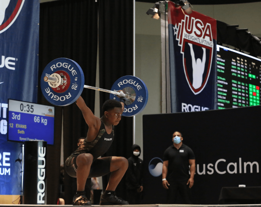 """Seth Evans winning the """"snatch"""" weightlifting event at the 2021 USA Weightlifting Youth Nationals."""