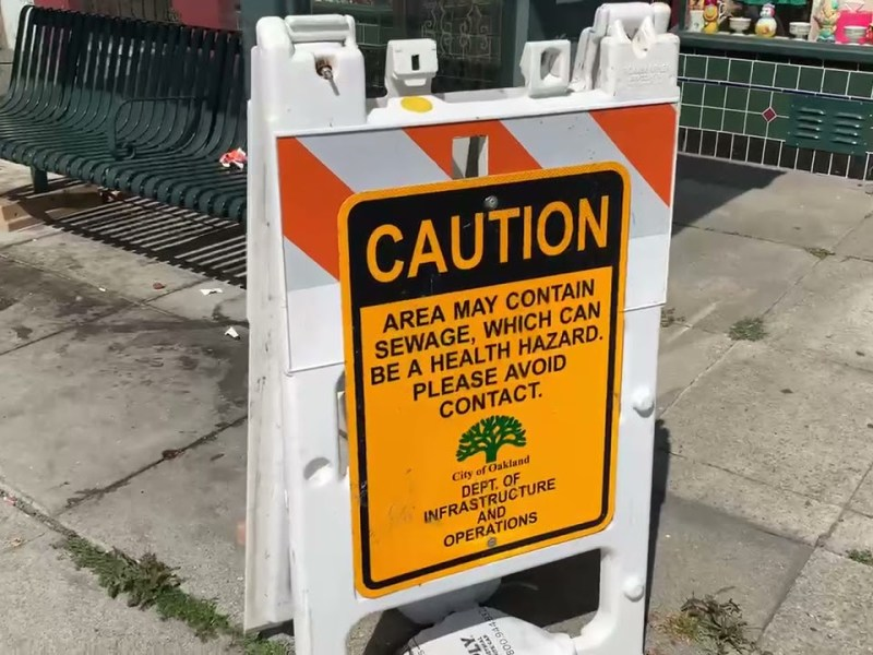 City Of Oakland Public Works Put Sign Of Sewage At Bus Stop But Didn't Clean It Up