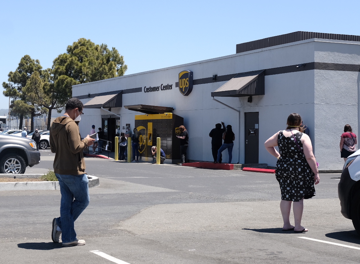 A long line of people waiting to claim packages outside the UPS Customer Care Center in East Oakland.