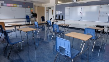 empty classroom with spaced desks