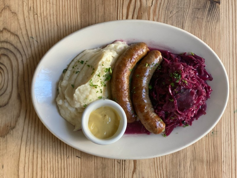 A platter with two German sausages, potatoes and sauerkraut. Similar dishes will be offered at Hofküche, a new biergarten in Oakland.