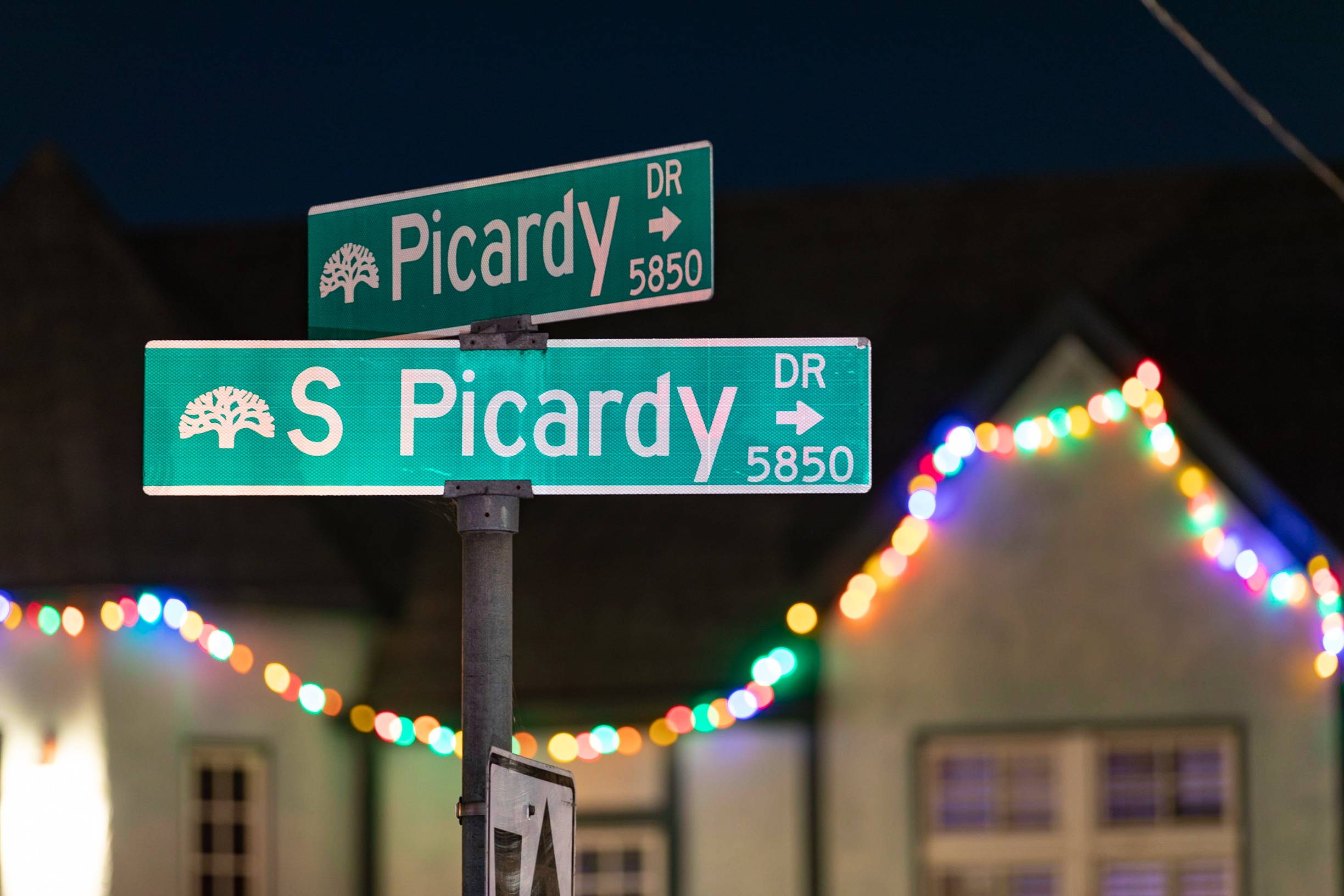 Picardy Dr street sign and Christmas decorations covering the house Picardy Drive residents.
