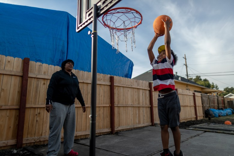 Vernetta Woods and her son Aidan, playing in their backyard