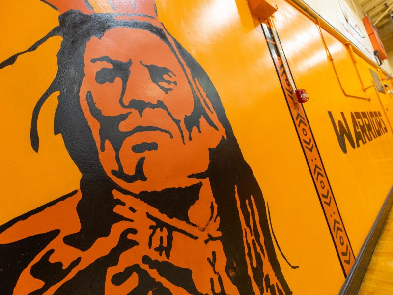 Warrior mascot painting on the gym wall for McClymonds High School in Oakland, California