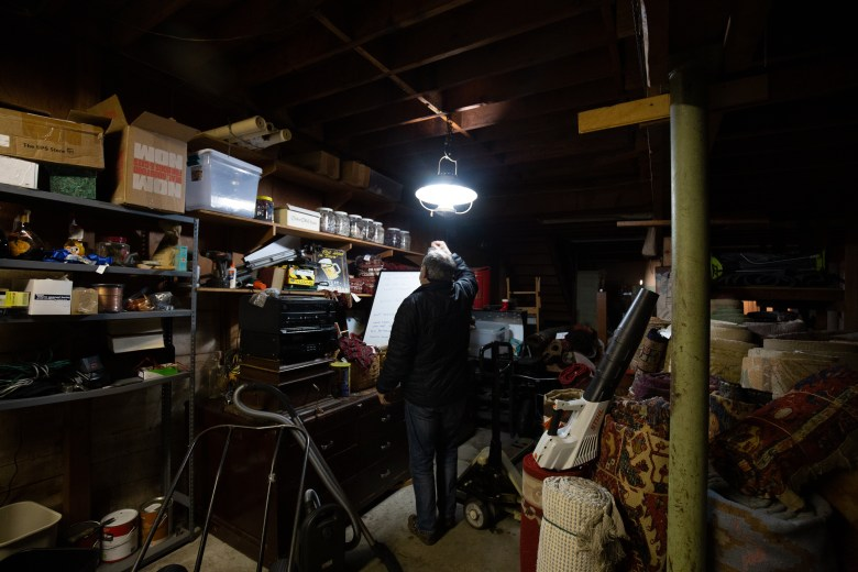 Peter Pap in the storage room of The Levant, where many vintage materials remain in boxes and untouched.