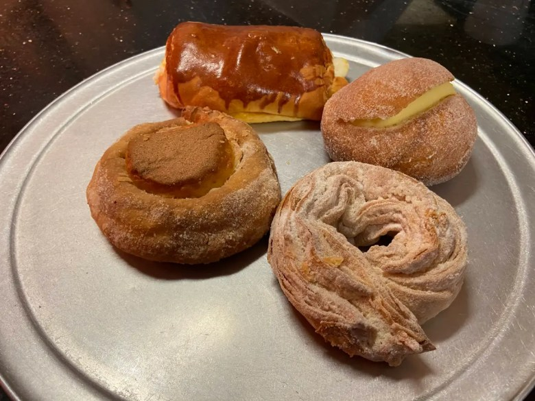 Pan dulce from Delicias, clockwise from top left to right, pan con queso, dona casera, ciudadela and ojo de buey.