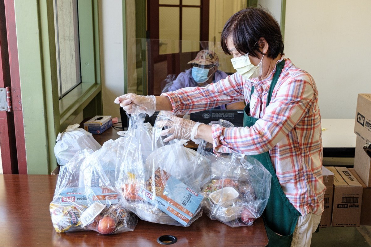 volunteer preparing meals for students