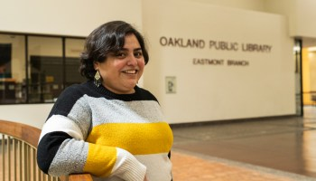 Marabet Morales reflects at the Oakland Public Library, Eastmont Branch