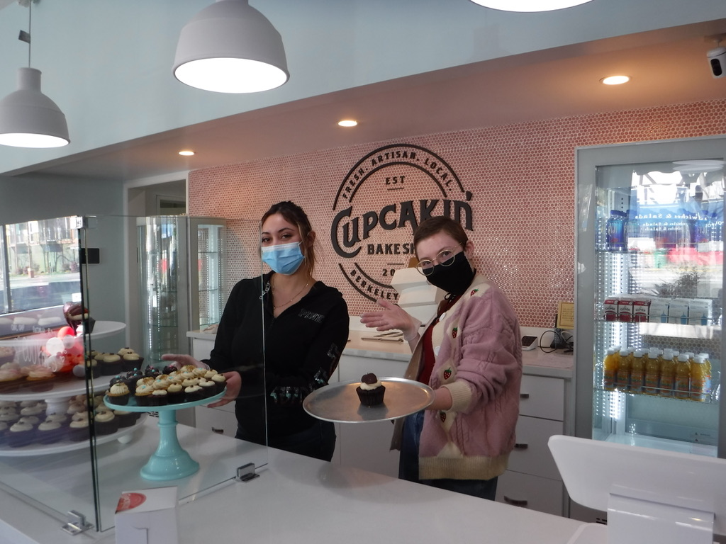 Staffers at the new Cupcakin' Bake Shop location in the former Virginia Bakery space in North Berkeley show of the wares. Photo: Joanna Della Penna