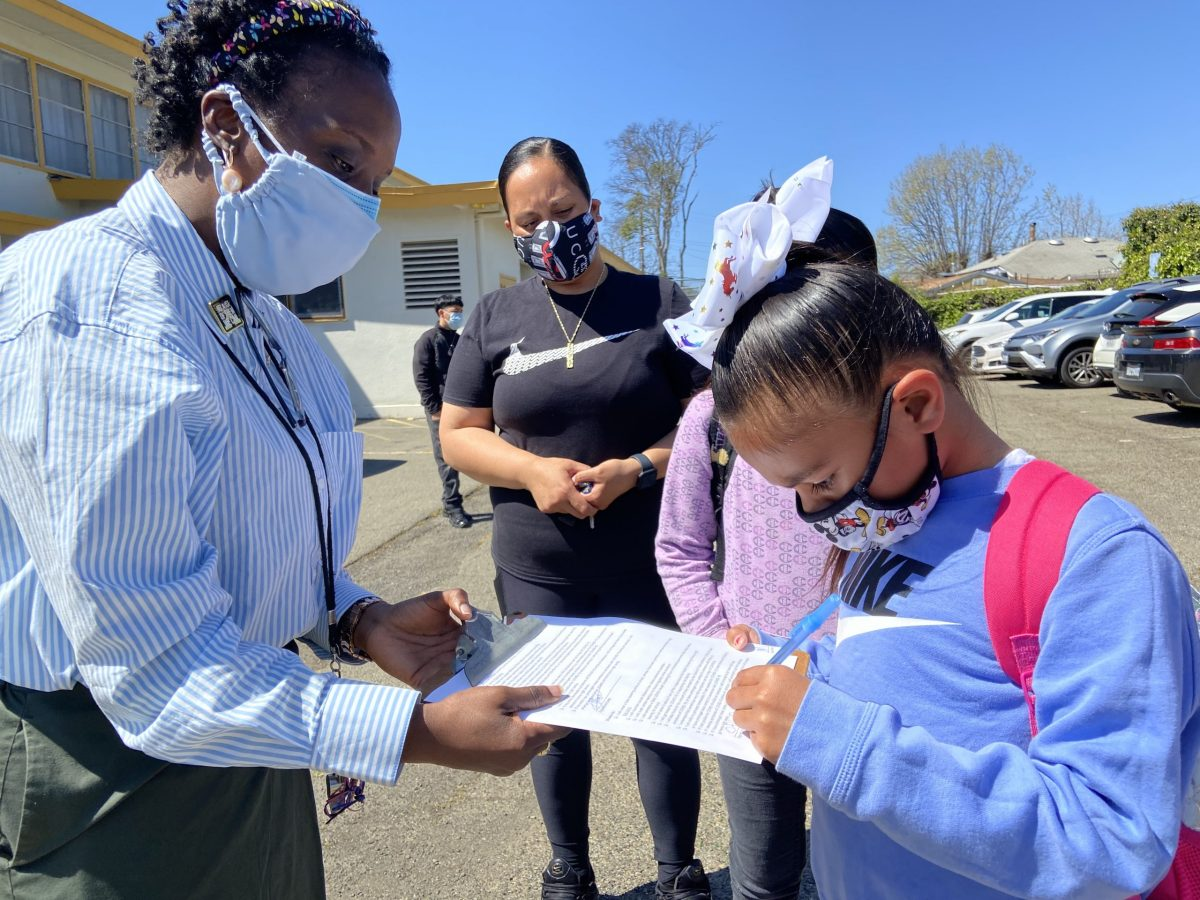 students signing health agreements