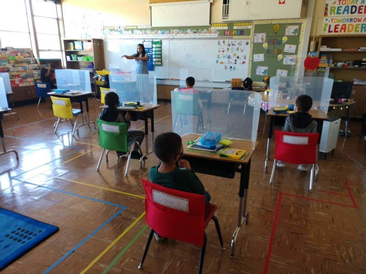 students sitting in class at school