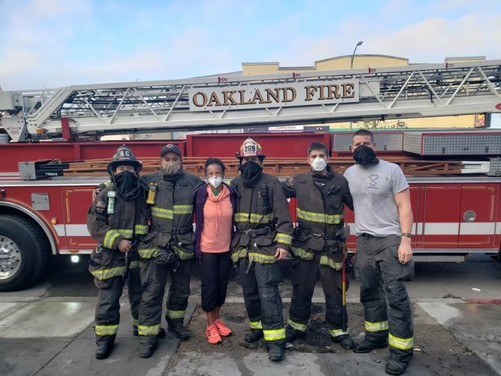 Regina Jackson with Oakland firefighters