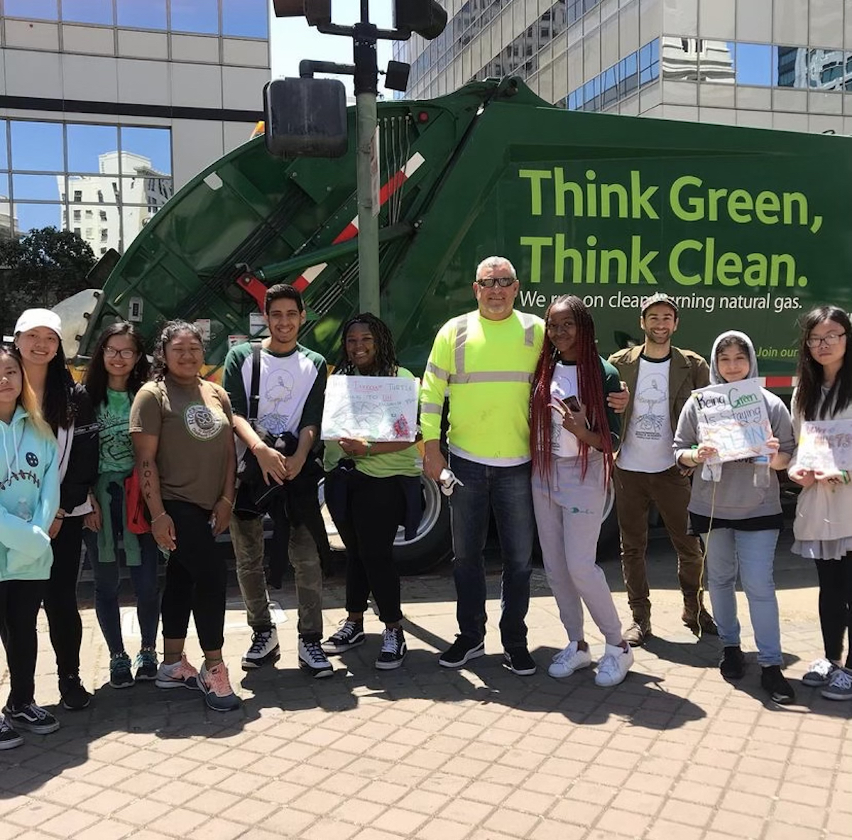 students at litter march in downtown oakland