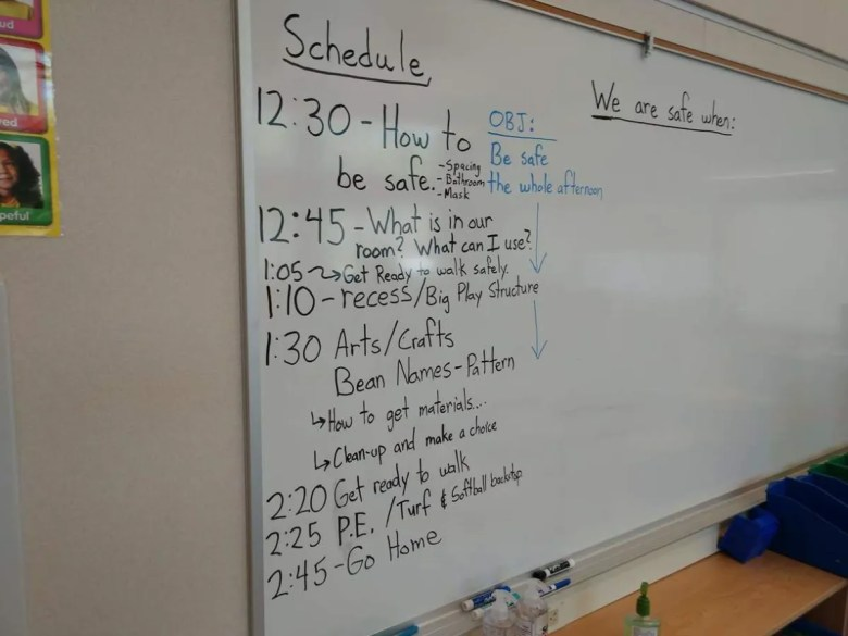 classroom whiteboard with schedule written on it