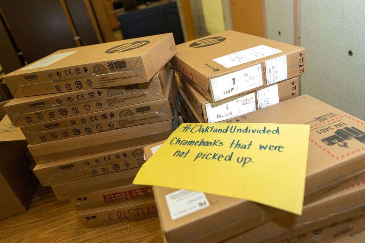 stack of chromebooks in boxes
