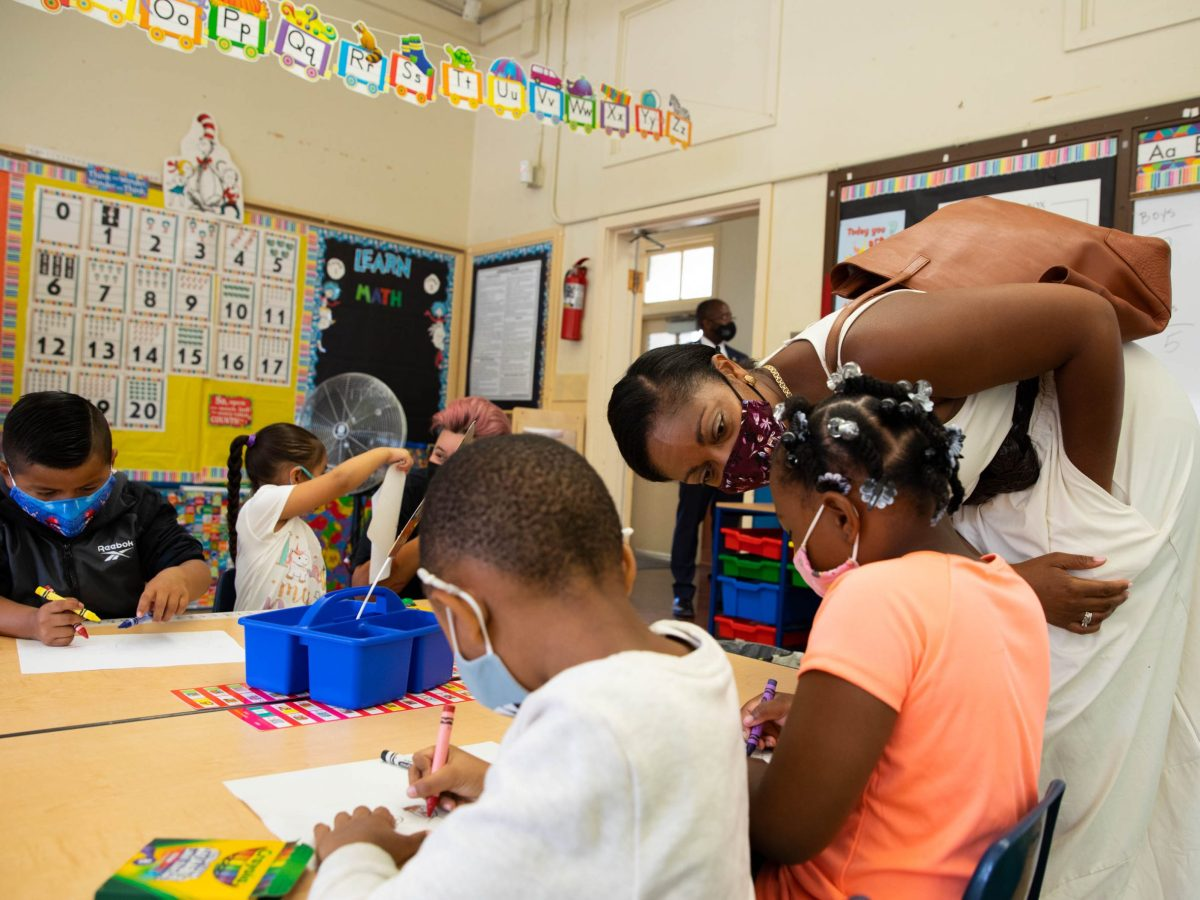 Oakland Unified School District Superintendent Kyla Johnson-Trammell talked with kindergarten students at Lockwood STEAM Academy on the first day of school. Face masks are mandatory, and on Aug. 11 Gov. Newsom announced all school staff must be vaccinated or tested.
