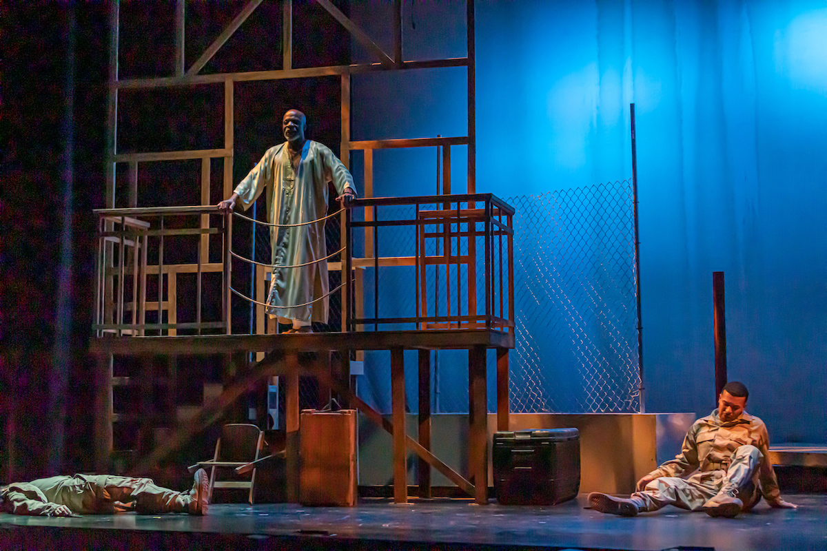 Othello (L. Peter Callender) hears of the death of Roderigo (Gabriel Ross) and wounding of Michael Cassio (Ariel Sandino) during a 2019 AASC performance.