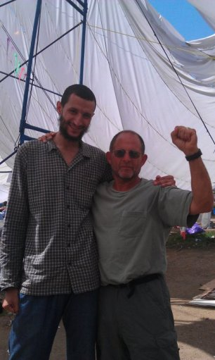 """An Egyptian and an American worker in Tahrir Square. """"Workers of the world, unite! You have nothing to lose but your chains. You have a world to win."""""""