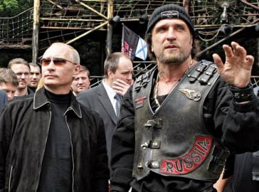 "Putin (left) with ""The Surgeon"", founder of the Russian fascist motorcycle gang the Night Wolves"