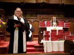 Rev. Brackett dedicates the new Bibles.
