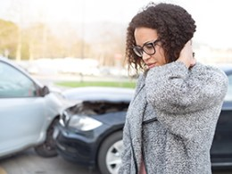 Injured woman feeling bad after having car crash