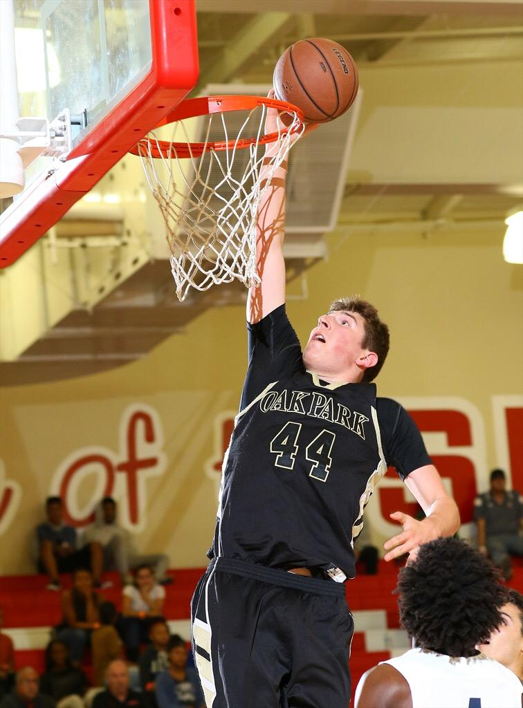 Power forward and sophomore Riley Battin dunks a basketball. This season, the boys' basketball team is playing in three of the top tournaments in Southern California, according to Head Coach Aaron Shaw (Photograph from MaxPreps).