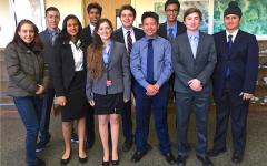 Left to right: Advisor Audrey Freeman, Neev Levy, Teju Pathy, Aneesh Ankareddy, Max Freeman, Jonathan Vu, Sriram Potluri, Jake Freeman, Harman Bans (Photograph courtesy of Speech and Debate Team).