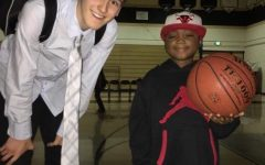 Luc Bodden poses with senior Wes Slajchert after a basketball game. The Municipal Advisory Council unanimously voted to make Sept. 14 Luc Bodden Day (photo courtesy of Wes Slajchert).
