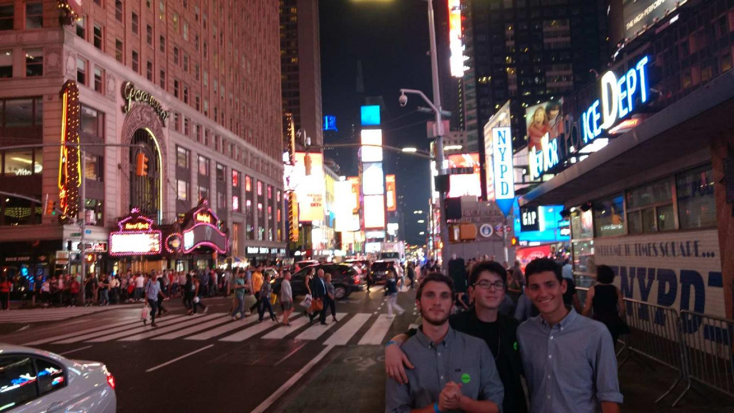 """Juniors Aiden Glikmann, left, and Benjamin Fuller, center, pose in Times Square. Glikmann and Fuller were invited to participate in the International High School Film Festival in New York City for their short- lm """"The Stall"""" (photo courtesy of Ben Fuller)."""