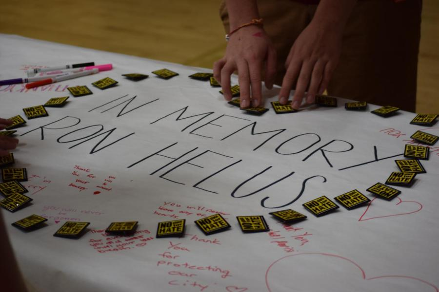 Students of Oak Park High School write promising messages in the memory of the 12 who died at Borderline.
