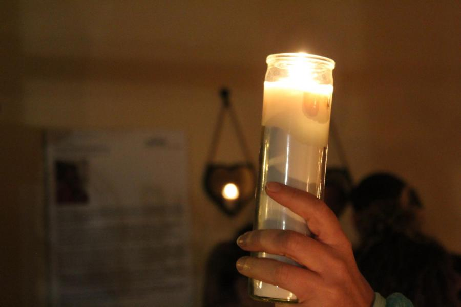 Community members gather with candlelight the night after a bar shooting to mourn those lost