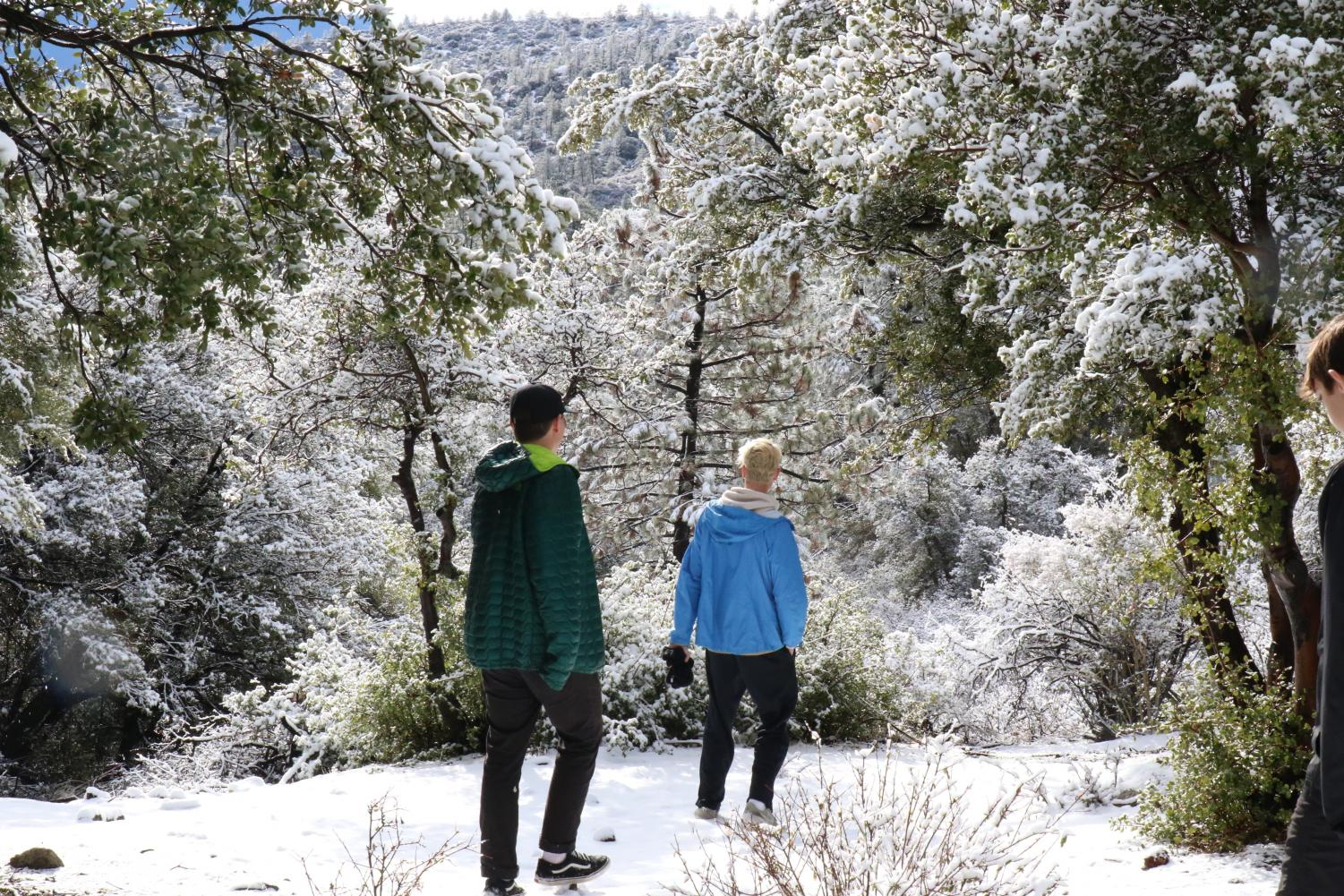 Caption: Seniors Marcus Jasso and Justin Jordan enjoy snow during the second Life Skills Retreat at Angeles Crest Christian Camp during recreation time