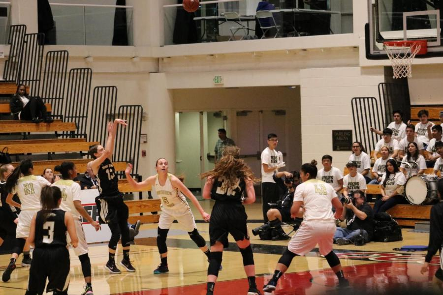 Junior+Mia+Foresti+shoots+while+Northview+senior%2C+Autumn+Rivera%2C+attempts+to+block+the+shot.+Girl%27s+varsity+basketball++lost+the+CIF+final+game+but+advanced+to+State+Playoffs