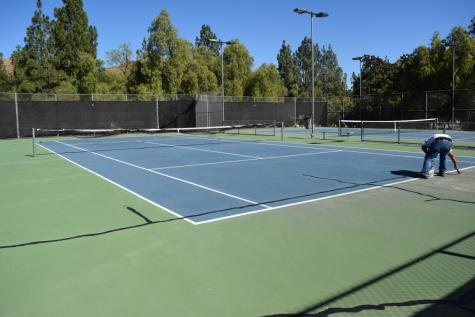 Work begins with the sanding as the tennis courts undergo their resurfacing.