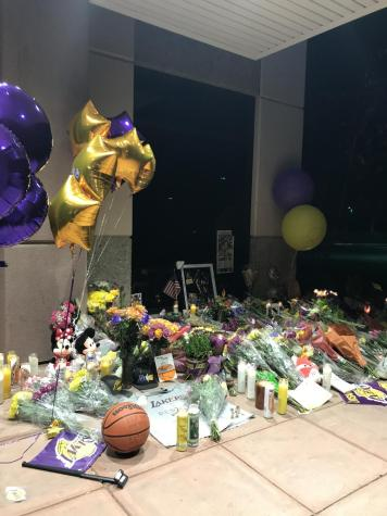 Fans leave flowers and mementos on Mamba Sports Academy's doorstep in memory of those lost in helicopter crash Jan. 26
